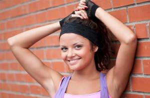 Beautiful teenage girl pose over red brick wall